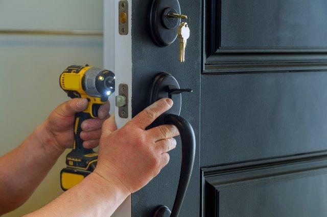 Locksmith breaks a door
